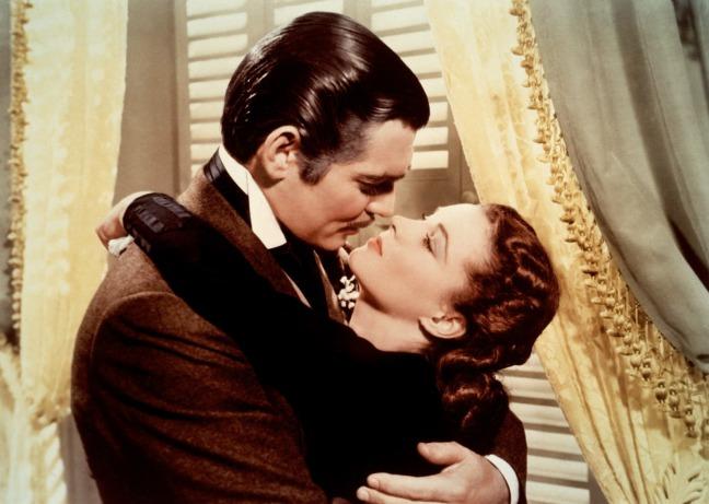 Rhett and Scarlett kissing by the curtains