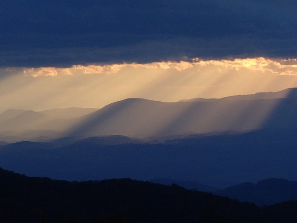 The sun cascades down over Amherst County, VA, taken from the meadow at Cold Mountain.