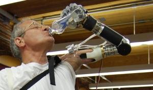 deka prosthetic arm drinking bottle of water