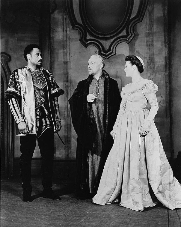 Othello, Iago, Desdemona.  Iago is already coming between them.